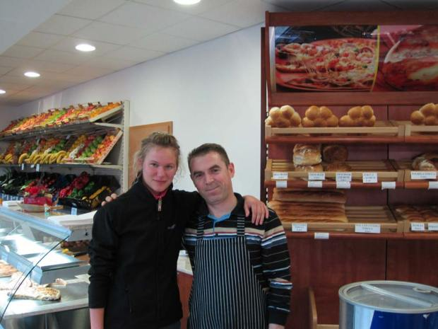 Remzi from Kosovo with Lidiya in his fruit store and bakery