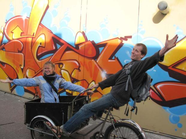Lidiya and me playing on a Christiania bike at the Floating City, Copenhagen